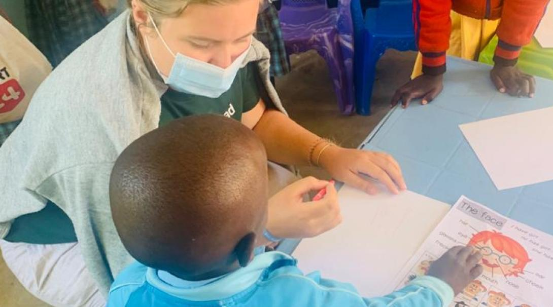 A Projects Abroad volunteer teaches young students at a Tanzanian school.